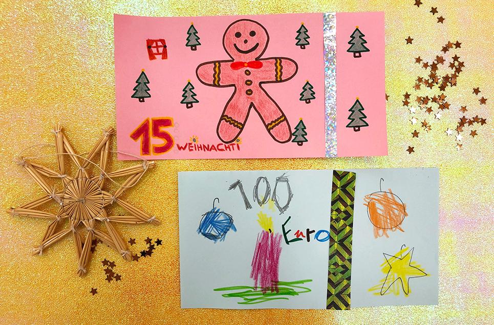 Zwei von Kindern weihnachtliche selbst gestaltete Banknoten